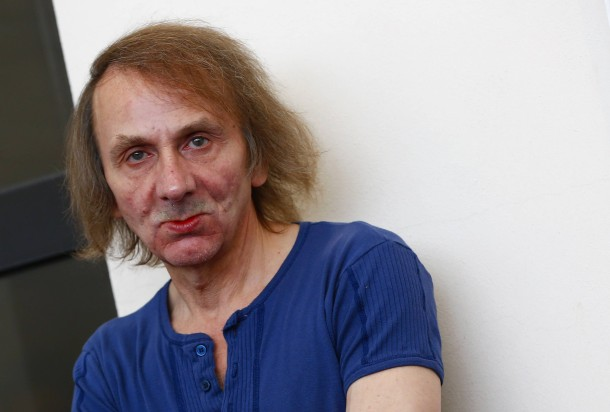 """Michel Houellebecq poses during the photo call for the movie """"Near Death Experience"""" at the 71st Venice Film Festival"""