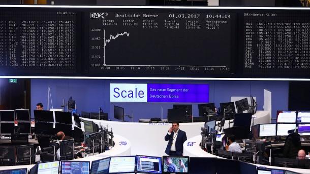 Dax steigt nach Fed-Reden wieder über 12.000 Punkte