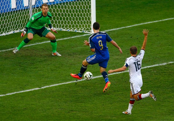 Argentina's Higuain scores a goal past Germany's goalkeeper Neuer and Lahm that was later ruled as offside during their 2014 World Cup final at the Maracana stadium in Rio de Janeiro