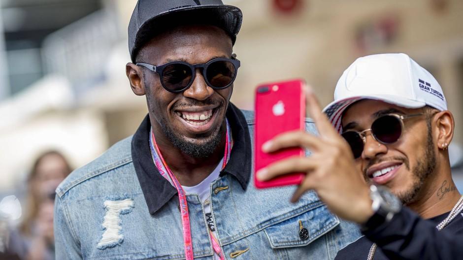 Zwei, die ziemlich schnell unterwegs sind: Usain Bolt (links) und Lewis Hamilton.