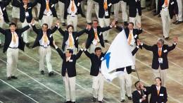 Die koreanischen Teams laufen gemeinsam ein