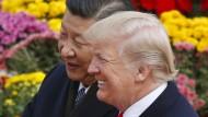 Donald Trump mit dem chinesischen Parteichef Xi Jinping im November im Peking.