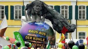 Klimaschützer kritisieren Angela Merkel
